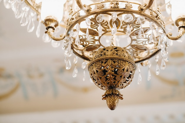 Antique crystal chandelier chandelier in the palace. large chandelier in the castle. Premium Photo