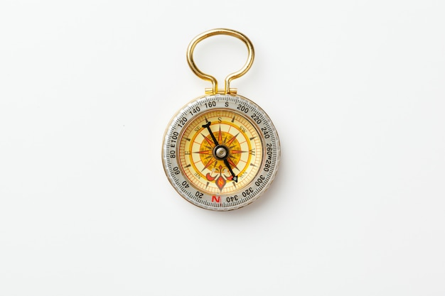 Antique golden compass isolated Premium Photo