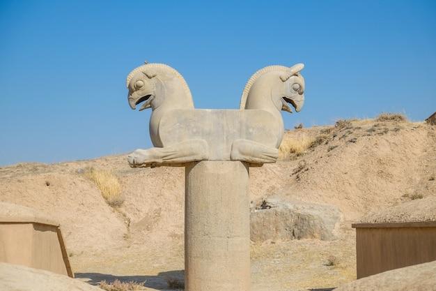 Antique sculpture of homa or huma bird. griffin-like column capital statuary in persepolis. Premium