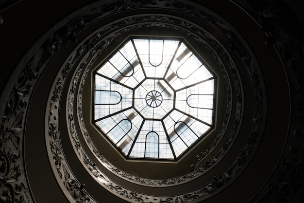 Antique spiral stairs and the glass ceiling in the vatican museum, rome, italy Free Photo