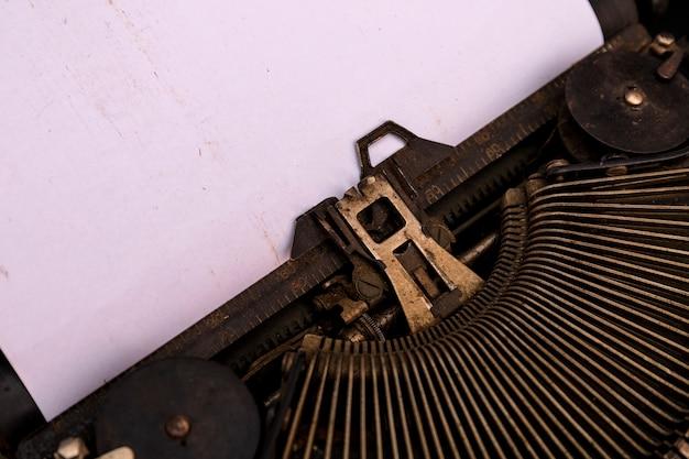 Antique typewriter. vintage typewriter machine closeup photo. Premium Photo