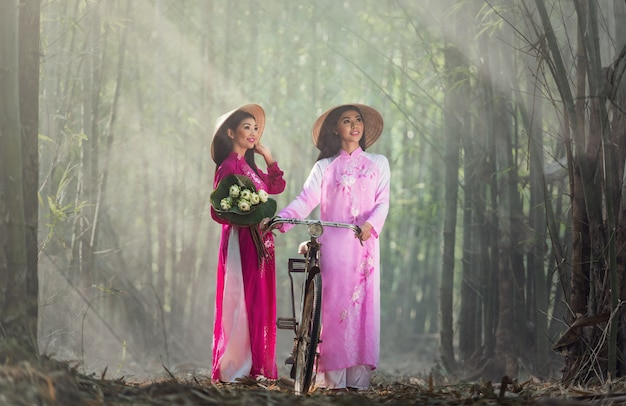 Ao dai is famous traditional costume for woman in vietnam Premium Photo