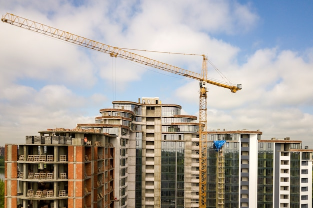 Apartment or office tall building under construction. Premium Photo