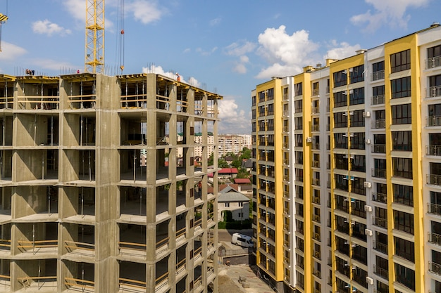 Apartment or office tall concrete building under construction. Premium Photo