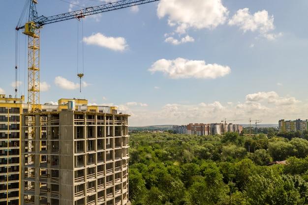 Apartment or office tall concrete building under construction. Premium Photo