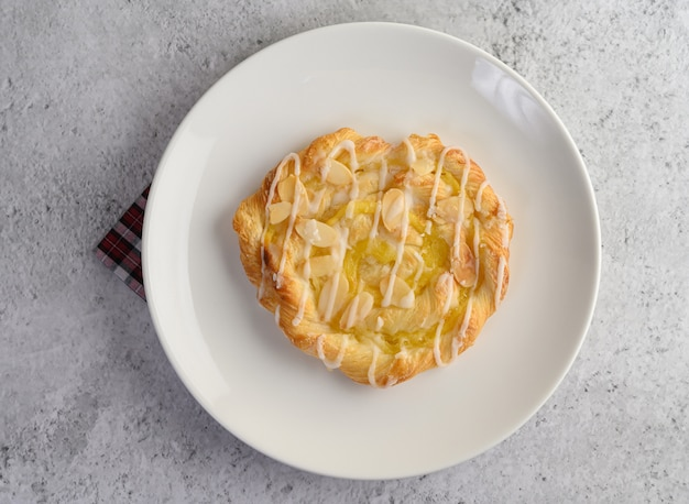 Appetizer of almond twist bread on white dish Free Photo