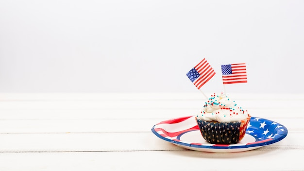 Appetizing cupcake on plate with american flags Free Photo