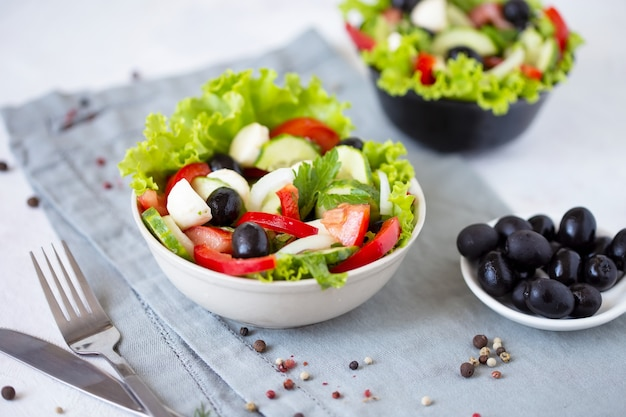 Appetizing greek salad in a plate on a served table Premium Photo