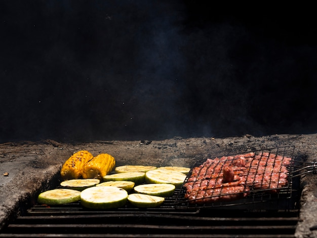 Appetizing grilling fresh vegetables and meat Free Photo