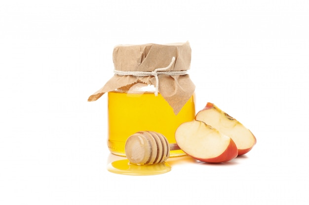 Яблоко и мед изолированные на белизне. натуральное лечение Premium Фотографии