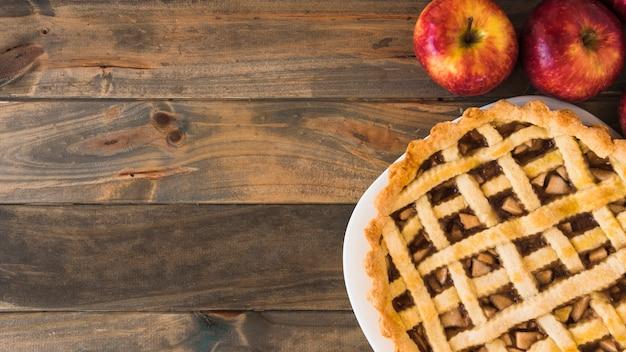 Apple cake near fruits Free Photo