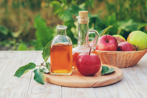 Apple cider vinegar in a bottle Premium Photo