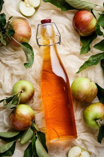 Apple cider vinegar and fresh apples Premium Photo