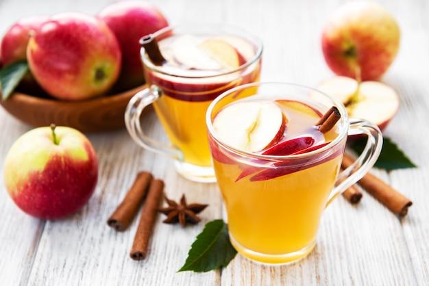 Apple cider  with cinnamon sticks Premium Photo