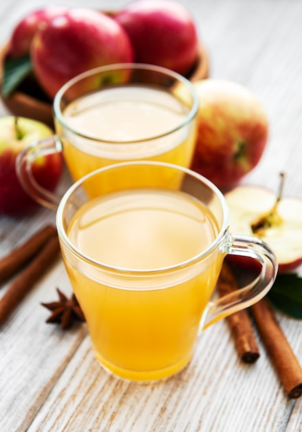 Apple cider  with cinnamon sticks Premium Photo