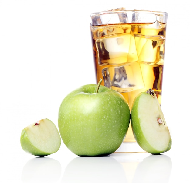 Apple juice with apples around Free Photo