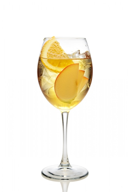 Apple and orange cocktail with a sparkling wine with ice in wine glass isolated on white Premium Photo