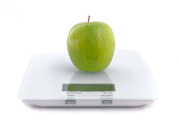 Apple on a scale Premium Photo