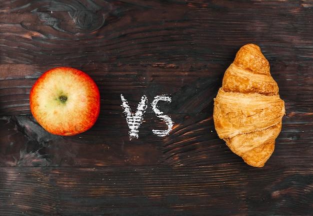 Apple vs croissant Free Photo