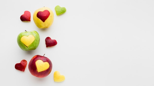 Apples and fruit heart shapes with copy space Free Photo