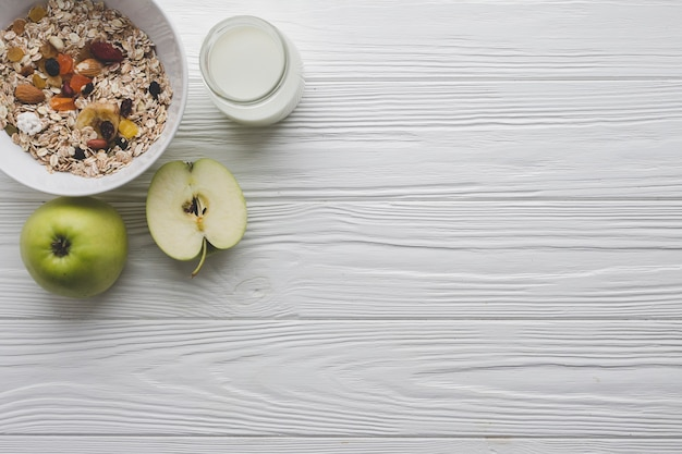 Apples and muesli for breakfast Free Photo