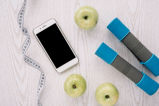 Apples and sport equipment Free Photo