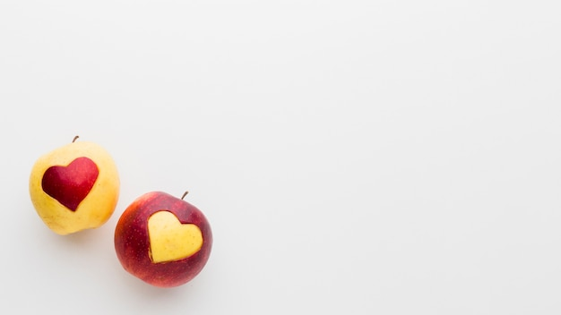 Apples with fruit heart shapes and copy space Free Photo