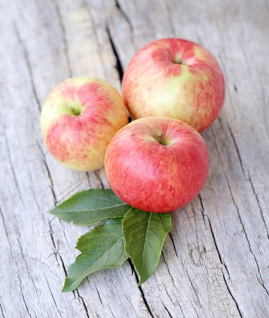 Apples on a wooden surface Free Photo