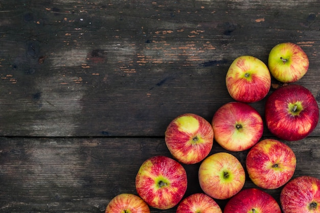 Apples on wooden table . fresh fruit backdrop with empty Premium Photo