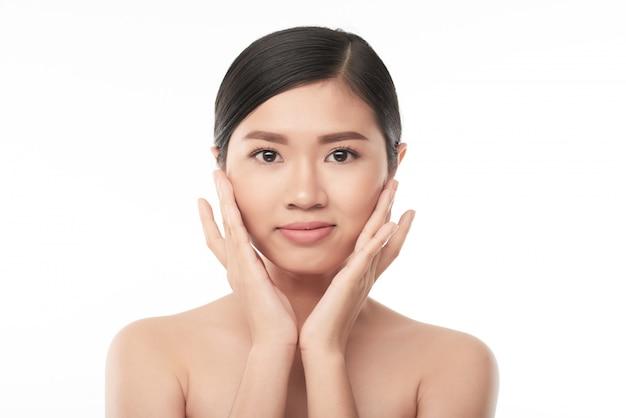 Applying face cream Free Photo