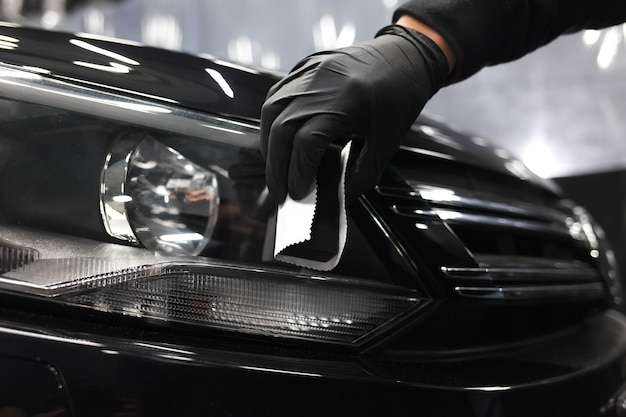 Applying of protective nanoceramics on car headlights Premium Photo