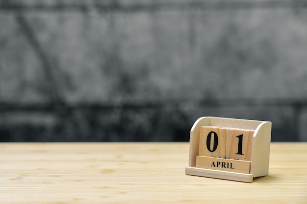 April 1 wooden calendar on vintage wood abstract background. Premium Photo