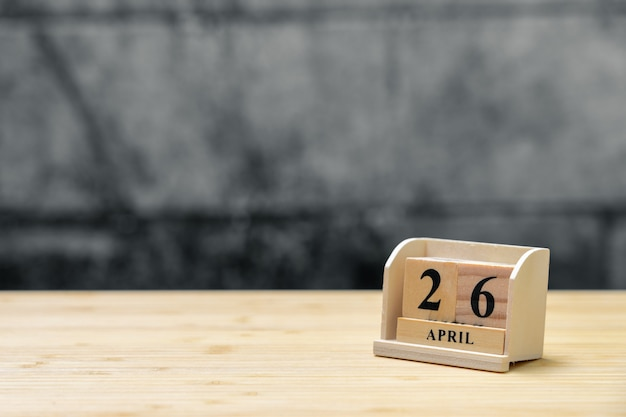 April 26 wooden calendar on vintage wood abstract background. Premium Photo