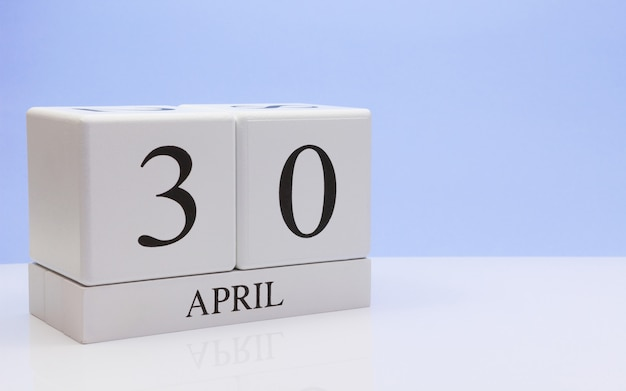 April 30st. day 30 of month, daily calendar on white table with reflection Premium Photo