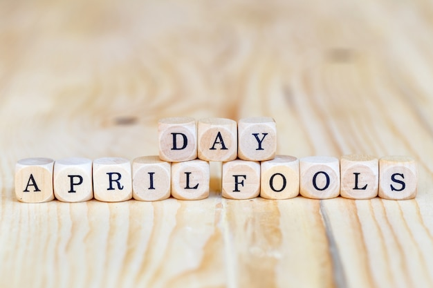 April fools' day, close up word made from wooden letters on the table Premium Photo