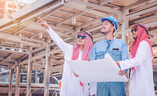 Arab businessman and engineer meeting project at construction site Premium Photo