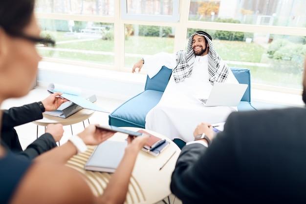 Arab businessman is discussing a business deal. Premium Photo