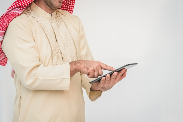 Arab businessman useing on a mobile phone Premium Photo