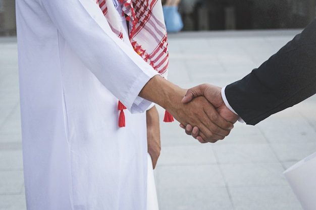 Arab businessmen worker handshaking on construction site Premium Photo