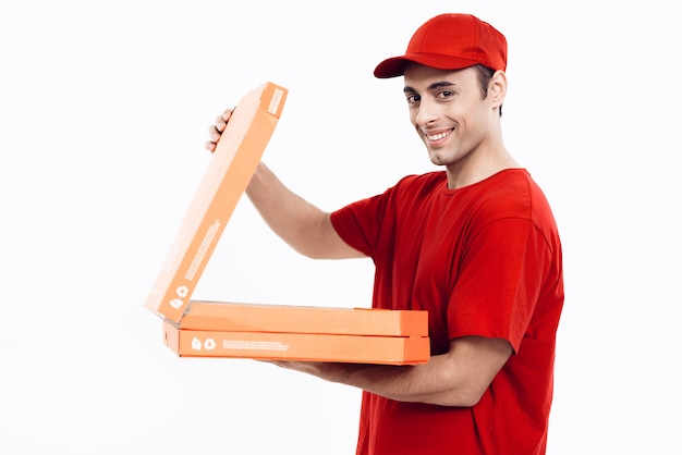 Arab deliveryman open pizza on white background. Premium Photo