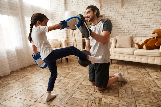 Arab family. man and young girl have boxing training. Premium Photo