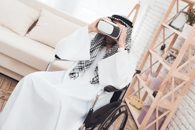 Arab man in a wheelchair with glasess virtual realy. Premium Photo