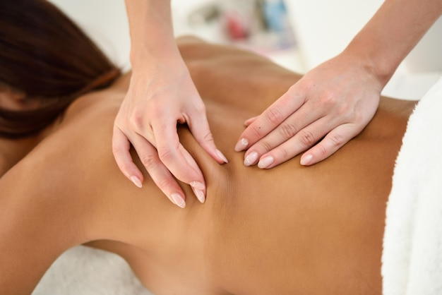 Arab woman receiving back massage in spa wellness center. Free Photo