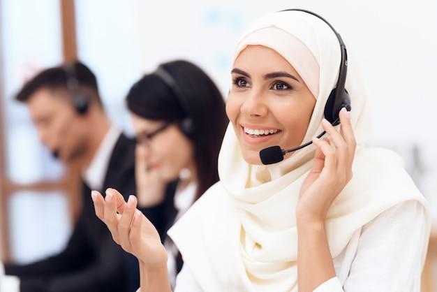 An arab woman works in a call center. Premium Photo