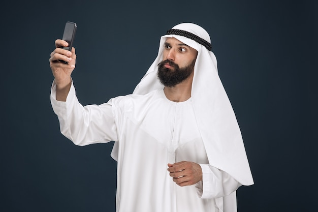 Arabian saudi man on dark blue studio Free Photo