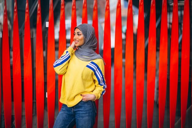 Arabian woman in hijab ouside in the street Free Photo