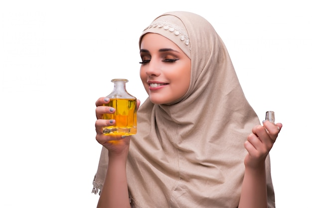 Arabian woman with bottle of perfume isolated on white Premium Photo