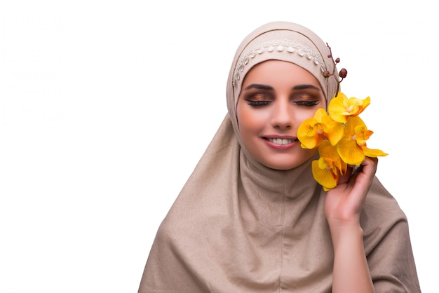 Arabian woman with orchid flower isolated on white Premium Photo
