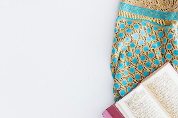 Arabic book and carpet Free Photo