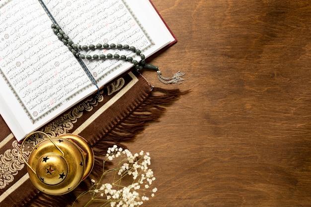Arabic elements and quran flat lay Free Photo
